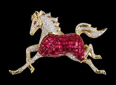 Lively horse brooch . Gold , ruby and diamonds. Brightly coloured and bold . mostly thats what attracted me to it the broght bold colours and non-conformist design. Lovely.