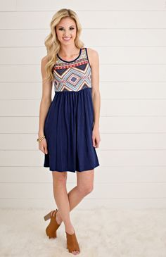 Wear this navy aztec dress to keep yourself cool on those hot Summer days! The…