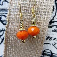 Orange Drop Beaded Earrings Faceted Glass and by fivedollarears