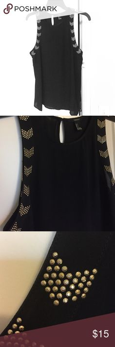 Black studded top Sleek forever 21 top--easy to dress up or down. Always great for work, to bars, to shows. Forever 21 Tops Blouses