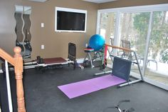 Another view.  The TV is actually installed in a box with a lazy susan swivel on the top & bottom so the exercise room & guest bedroom can share it.  A total Money Hunters' solution!