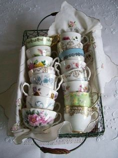 A basket of teacups - nice way to display them when they are not being used