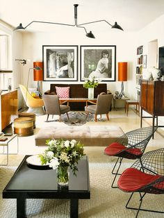 Living room. Symmetry.  Lamps. Mid century modern.  Division of space.  Ottoman.  Light fixture.