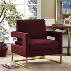 """Avery Maroon Velvet Chair - TOV-A110 for $385  Description :  Inspired by our love for luxe, modern design the Avery chair radiates sophistication and grandeur. With a glossy gold finish and gorgeous curves, this chair is available in several sumptuous upholstery options. The Avery is a must-have for any room.  Color : Maroon  Leg Color : Gold  Product Material : Velvet  Dimensions :  Chair : 33.5""""W x 29""""D x 35.5""""H"""