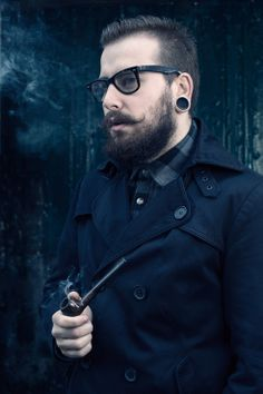 man's portrait.beard, glasses,pipe