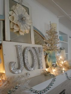 Beautiful Christmas Decorations: I love all of it! Wreath, Joy, Glitzy Christmas Tree...