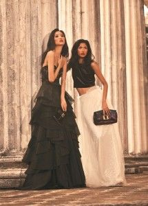 Princess diaries  Femininity is at its finest with long, voluminous skirts fit for royalty  (From left) On Ana: Black lace corset with tiered tulle dress, Jaz Cerezo; black suede 'Slim Suede Coal' clutch, Louis Vuitton. On Manuela: Black velvet midriff, Proudrace at Myth; white tulle princess skirt, Dennis Lustico; multicolor quilted jacquard 'Altair' clutch, Louis Vuitton