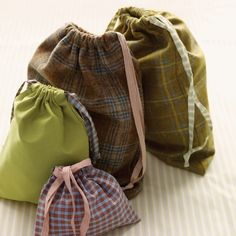 Whether you're packing a suitcase or storing items at home, these drawstring pouches are handy to have around. Made in a range of sizes, they are perfect for stowing jewelry, shoes, and even laundry.