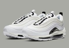 premium selection 0f4a3 75e61 Shimmering Silver Accents Appear On This Womens Nike Air Max 97