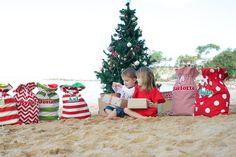 A beachy Christmas Aussie style!  Santa Sacks and Christmas tree on glorious golden sand! www.longandtheshort.com.au Personalised Santa Sacks $60 AUD
