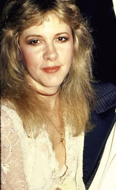 Stevie wearing cream lace and a simple gold cross on a chain at the American Music Awards in 1983 ☆♥❤♥☆
