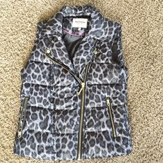 Juicy Couture Puffy Vest Leopard print puffy vest. In very good condition. Only worn once or twice at most. Very clean inside and out. The feathers inside are perfect for these cold weather months! Offset zipper and pockets. Juicy Couture Jackets & Coats Vests