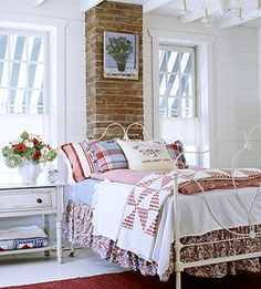 Farmhouse Cheer - Make guests feel like they're visiting Grandma's house with a comfortable room inspired by country style. The chandelier complements the white iron bed. Layers of quilts, a floral bed ruffle and an embroidered pillow recall simpler times.