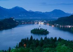 At Slovenia's Lake Bled, you'll see mountains in every direction, including the Julian Alps and the Karavanke range. (From: Photos: 12 Most Beautiful Lakes )