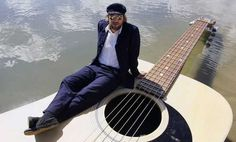 This guy's guitar floats on water.