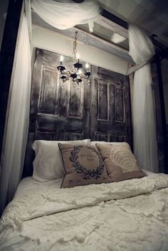 Dramatic Headboard Made With Reclaimed Doors