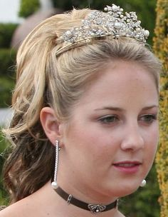 Princess Theodora of Greece wearing the Antique Corsage Tiara. Queen Ingrid of Denmark had this tiara made from a devant de corsage, or set of brooches, that she inherited from her grandmother, Queen Victoria of Sweden. The tiara was a gift to Princess Theodora's mother, Queen Anne-Marie of Greece (then Princess of Denmark), from her parents, King Frederick IX and Queen Ingrid of Denmark, on the occasion of her 18th birthday in 1964.