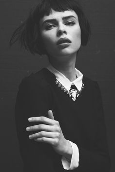 blunt bob with bangs...I've always wanted a hair cut like this but thought I couldn't get away with it because I have a square face, but this model has literally got the same face shape as me and she looks awesome...maybe i'll reconsider!