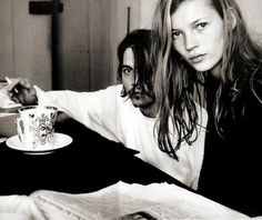 Johnny Depp and Kate Moss sharing a cup of coffee.