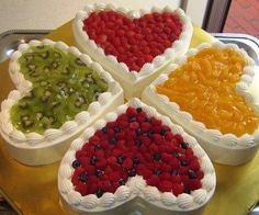Fruit atop heart-shaped cakes.  We'll take a piece please!
