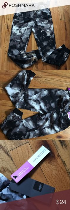 Mossimo tapered pants Mossimo floral pants tapered bottom black white gray. BRAND NEW XS.           Matching top available as well Sold separate Mossimo Supply Co Pants Trousers