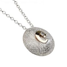 Round sterling silver and 18ct gold vermeil pendant with feature Irish Swirl. Metal: Silver