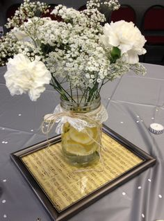 Bridal shower centerpiece. Dollar store frame, scrapbook paper, mason jar with lemons, carnations and babies breath.