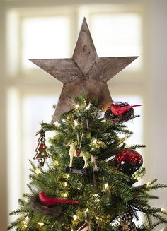 """Reclaimed Wood Tree Topper / Home Decorators / 23"""" H x 15"""" W - think I like it even though I usually like lighted tree toppers."""