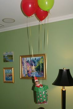 Elf on the Shelf - hot air balloon ride. I just immediately picture in elf that looks like my best friend, Betsy on the wall. haha