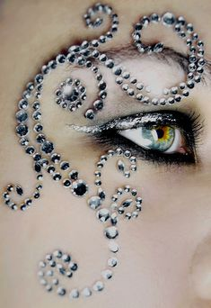 Intricate scrolls of crystals compliment a silver smokey eye.
