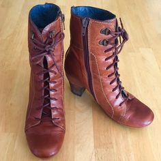 Anthropologie Hispanitas Lace-up High Heel Booties High heeled lace up booties by Hispanitas in a rich lightly distressed cognac leather. Has side zippers so you can put them on with ease.  In excellent condition, worn maybe twice - as you can see from the photos, the soles are barely worn down at all and the 'Hispanitas' logo is still visible on the heels. Interior is nice blue leather with the brand printed in silver (see last photo). There are some minor scratches but these go with the…