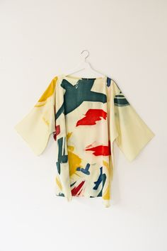 Hand printed Silk Kimono dress. This dress was dyed and screen printed at our studio in York, we love the bold print! All our products are one of a kind due to the nature of our dyeing and printing techniques however we are able to recreate similar patterns and colours. If you would like to order a similar design please email us at info@meiji-designs.co.uk or take a look at our Etsy shop.