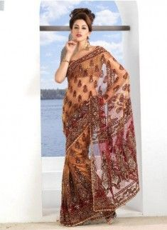 http://www.pakistanfashionmagazine.com/dress/pakistani-dresses/heavy-stone-and-beads-embroidered-bridal-saree-collection-2013.html