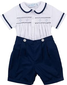 Classic navy and white is perfect for year round events! Solid navy blue shorts button on to white short sleeve shirt at waistline. Shorts have elastic back, for a comfy fit of your cute little boy. Navy, light blue, and white smocked yoke. Pearlized front button closure. #fashionable #baby #clothes #cute Navy Blue Shorts, White Shorts, Spring Dresses, Short Dresses, Smocked Baby Dresses, White Two Piece, White Short Sleeve Shirt, Cute Little Boys, Boy Shorts