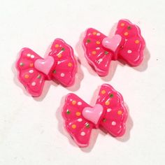 Hot pink polka dot hearts bow resin cabochon. For embellishing baby headbands, barefoot baby sandals & other DIY projects. Shabby roses, FOE, elastics & more available.