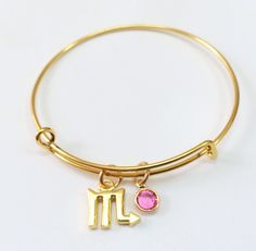 Happy birthday, October!!! Celebrate your own birthday or get the perfect gift for a loved one. Scorpio - Purposeful, Self-Will, Unyielding. Gold plated adjustable bangle with gold plated scorpio zodiac sign and swarovski october birthstone charms $22. Available @ http://shareindipity-com.myshopify.com/collections/zodiac-collection/products/gold-bangle-scorpio-with-october-birthstone #zodiac #scorpio #birthday #bangle #october #ootd #ootn #instafashion #photooftheday #gold