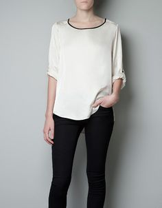 BEIGE BLOUSE WITH BLACK NECKLINE (After seeing white /black collar shirt on Moneypenny I realized I have to have this! )