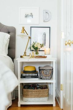 bedside table styling brass lamp baskets tufted headboard the everygirl chicago home and office tour