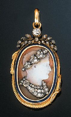 A Fine Cameo Habille of Napoleon   The sardonyx cameo carved with the Emperor's head in profile to the right, his laurel wreath and cloak about his shoulders set with diamonds and rose-cut diamonds, the cloth secured by a clasp with the initial N, the frame composed of two entwined serpents with blue enamel detail, with diamond-set laurel spray surmount, suspension loop, first half of the 19th Century, 5cm. overall height [I have my doubts this was made after Waterloo]