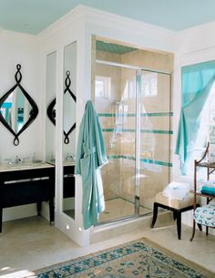 An aqua ceiling adds instant beachy charm to this bathroom!