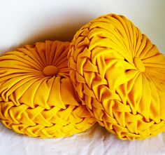 Made to Order- Handmade 1960s Vintage Inspired Round Smocked Decorative Pillows Mustard Yellow Twill. $84.00, via Etsy.