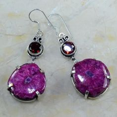 Magenta Solar Quartz, Garnet, & Silver Earrings Gorgeous magenta solar quartz and garnet gemstone earrings. I cannot find a 925 stamp on them so I will just say silver overlay.  They are 2.5 inches in length.                                               They match a magenta solar quartz and sterling silver bracelet I have for sale in another listing. You can buy them separately or together. Boutique Jewelry Earrings
