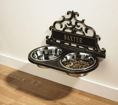 Personalized Wall-Mount Pet Feeder / Personalized Wall-Mount Pet Feeder. Mount this handsome feeding station to the wall and your pet will enjoy better digestion while you enjoy less mess! http://thegadgetflow.com/portfolio/personalized-wall-mount-pet-feeder/
