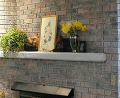 DIY-How to paint old red brick fireplace to look like stone. Vacuum first to remove debris. Wipe brick down with barely wet sponge. Use a nappy roller for texture. Roll on oil based primer, next roll on white paint very lightly. Use a damp sponge to dab a few colors on each brick. I like tan, and gray. Let some of the white show through