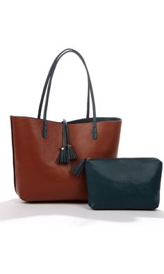 Reversible, soft pebbled faux leather tote with shoulder straps, cool tassel detailing and a removable inside pouch (to hold your smaller essentials).