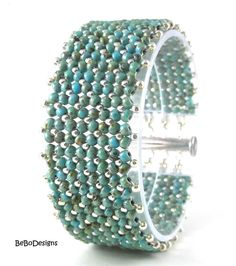 This stitch is called flat chenille and I've used Japanese Turquoise Picasso size 8 seed beads and Toho size 11 seed beads in Aluminum Permanent Galvanized.  The bracelet measures 7 1/4 inches long and 1 inch wide.  Thank you for visiting my Etsy shop!  ♥♥♥♥♥♥♥♥♥♥♥♥♥♥♥