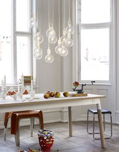Muuto - Adaptable table, designed by TAF Architects, in a dining setting together with E27 pendant lamps by Mattias Ståhlbom.