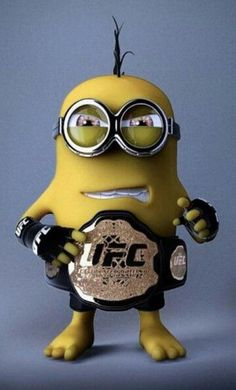 UFC Minion - Ok.I will NEVER understand the fascination with watching two grown men beat each other to a pulp but he likes UFC. Minion Rock, Minion S, Minion Banana, Cute Minions, Minions Despicable Me, Girl Minion, Minion Party, Minion Wallpaper Iphone, Batman Minion