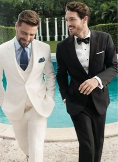 + Ideas for Cool Mens Summer Wedding Attire To Try This Season swiming-pool-behind-two-smiling-men-black-tie-attire-for-men-one-wearing-black-two-piece-suit-with-a-bowtie-the-other-in-a-white-three-piece-su. Gentleman Mode, Gentleman Style, Summer Wedding Attire, Wedding Suits, Wedding Groom, Wedding Men, Mens Fashion Suits, Mens Suits, Men's Fashion