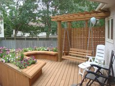 Treated brown deck with pergola, built-in swing and planters. Deck Planter Boxes, Planter Bench, Deck Planters, Planter Ideas, Deck Box, Small Pergola, Deck With Pergola, Pergola Kits, Pergola Cover